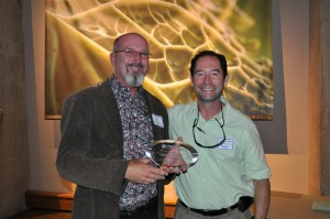 David Salman (right) presents the Individual Partner Award to Kelly Grummons (left)