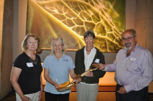 Lynn Mitzlaff, Margaret Cozine and Hollis Hassenstein of Durango Botanic Gardens accept the Golden Shovel Award from Panayoti Kelaidis