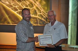 Zach Versluis accepts the Showcase Garden Award from Plant Select president, Gene Pielin for the City of Aurora Xeriscape Demonstration Garden